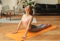 fitness woman in sportswear in yoga cobra pose on yoga mat - PhotoDune Item for Sale