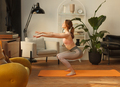 athletic female woman doing squats exercise in living room interior - PhotoDune Item for Sale
