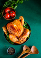 Whole roasted chicken and spices on a bright green background - PhotoDune Item for Sale