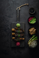 Braise beef short ribs, asian style with rice and radish, dark photo, flat lay - PhotoDune Item for Sale