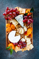 Big plate with appetizer assortment. Grape, cheese, nuts, jam and bread. - PhotoDune Item for Sale