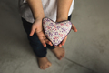 Baby boy hands giving toy heart. - PhotoDune Item for Sale