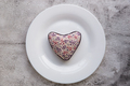 Red heart on plate on wooden background. - PhotoDune Item for Sale