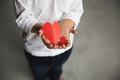 Two baby hands holding red paper hearts. - PhotoDune Item for Sale