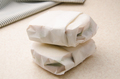Two sandwiches wrapped in parchment paper on kitchen table - PhotoDune Item for Sale
