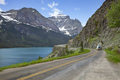Camper travels alongside St Mary's Lake and mountains in Glacier National Park - PhotoDune Item for Sale