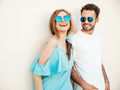 Portrait of handsome man and his beautiful girlfriend posing outdoors - PhotoDune Item for Sale