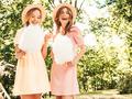 Portrait of two cute beautiful women posing outdoors - PhotoDune Item for Sale