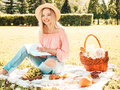Portrait of young beautiful woman posing outdoors at picnic - PhotoDune Item for Sale