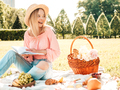 Portrait of young cute woman posing outdoors at picnic - PhotoDune Item for Sale
