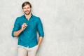Portrait of young handsome man posing in studio - PhotoDune Item for Sale