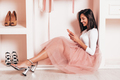 Portrait of stylish young woman posing in pink wardrobe - PhotoDune Item for Sale