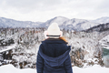 Young woman traveler looking at beautiful landscape in winter - PhotoDune Item for Sale