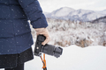 Young woman traveler looking at beautiful landscape in winter with camera - PhotoDune Item for Sale