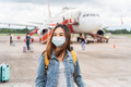 Young woman wearing a face mask at the airport, New normal lifestyle concept - PhotoDune Item for Sale