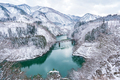 Beautiful landscape of Tadami line train across Tadami river in winter at Fukushima, Japan - PhotoDune Item for Sale