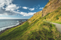 Steep green slope with tourist path. Ireland - PhotoDune Item for Sale