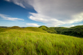 green grass climbs sumba island indonesia photo - PhotoDune Item for Sale