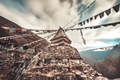 Prayer flags and buddhist stupa on trekking route - PhotoDune Item for Sale