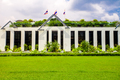 Asia botanic garden building exterior and green grass lawn with plant and flags on roof top - PhotoDune Item for Sale