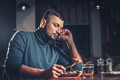 Man eating and speaking on mobile phone - PhotoDune Item for Sale