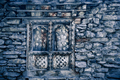 Blue stone wall with wood window. Background - PhotoDune Item for Sale