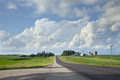Rural highway in southern Minnesota with fields and a farm beneath dramatic clouds - PhotoDune Item for Sale