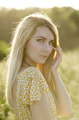 Young blond caucasian female model enjoying outdoor activity at meadow summer evening time - PhotoDune Item for Sale