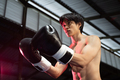 boxer fighter in boxing gloves challenge his opponent with hand gesture - PhotoDune Item for Sale