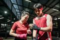 portrait of couple fighter applying bondage tape on hands - PhotoDune Item for Sale
