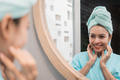 Woman looking on reflection in the mirror after shower - PhotoDune Item for Sale