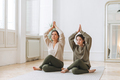Attractive mother middle age woman and daughter teenager ptactice yoga together in bright room - PhotoDune Item for Sale