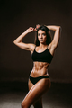 sexy fitness woman posing in underwear indoors on black background - PhotoDune Item for Sale
