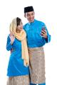 muslim couple using mobile phone - PhotoDune Item for Sale