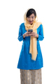 excited muslim woman looking at her phone isolated - PhotoDune Item for Sale