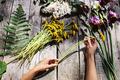 wreath of dandelions flowers handmade on wood table - PhotoDune Item for Sale