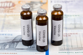 Vaccine against Covid-19 on the background of Danish krone - PhotoDune Item for Sale