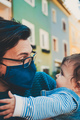Young father wearing a face mask while hug his baby - PhotoDune Item for Sale