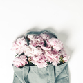 Blue cotton eco tote bag with peony flowers on white background, flat lay - PhotoDune Item for Sale