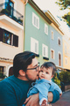 Adorable portrait of a young father hugging his baby - PhotoDune Item for Sale