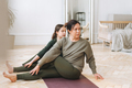 Attractive mother middle age woman and daughter teenager ptactice yoga together in the bright room - PhotoDune Item for Sale