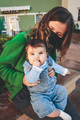 Image in green tones of a young single mom with her baby during covid pandemic - PhotoDune Item for Sale
