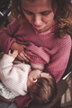 Young woman breastfeeding her baby - PhotoDune Item for Sale