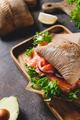Healthy sandwich with rye bread bun, salmon, avocado, onion - PhotoDune Item for Sale