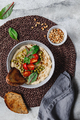Hummus with green pea, pine nuts, tomatoes and swiss chard. - PhotoDune Item for Sale