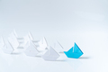 Leadership conceptual using blue paper ship - PhotoDune Item for Sale