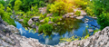 Blue river at bottom of canyon with green trees on bank - PhotoDune Item for Sale