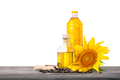 Bottles of sunflower oil with seeds and sunflower on wooden table isolated on white background - PhotoDune Item for Sale