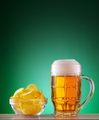 Mug of light beer with foam and chips - PhotoDune Item for Sale