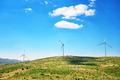 Wind generators on a plain under a blue sky - PhotoDune Item for Sale